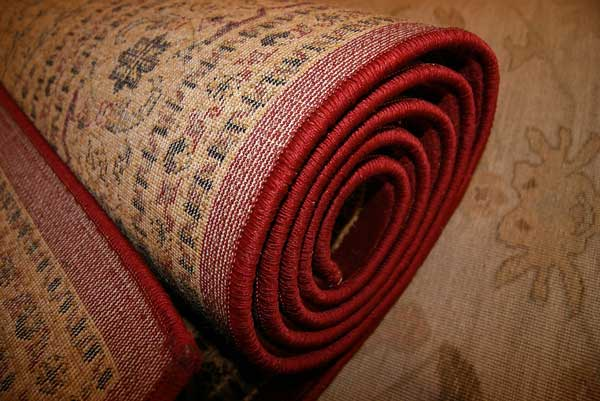 How-to-secure-area-rug-on-top-of-the-carpet-therugsgalfeatured-image